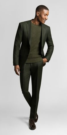 You can't go wrong with a dark green suit in fall or winter. Full steam ahead with this custom suit at your side.