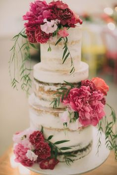 3 tier semi-naked wedding cake decorated with fresh pink flowers