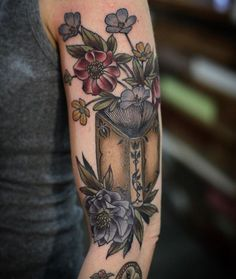 Love this tattoo. Books+flowers are love.