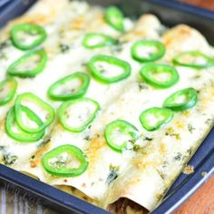 Steak Enchiladas made with thinly sliced steak, sauteed with onions and peppers, and topped with delicious jalapeno cilantro cream sauce.