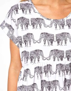 Elephant dress.... this reminds me a lot of Area's Animals wallpaper by Claire Leina
