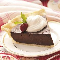 Dark Chocolate Cream Pie Recipe from Taste of Home -- Topped with a dollop of fluffy whipped cream, it will have chocolate fans standing in line!