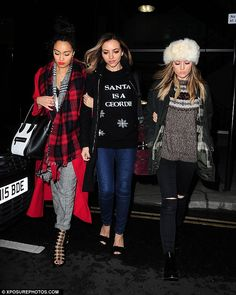 Winter warmers: The girl group - notably missing fellow member Jesy Nelson - looked festiv...
