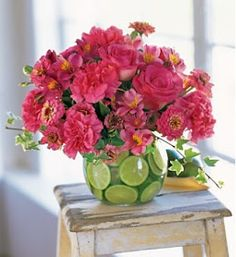 by Dori: Beautiful Spring floral design. Hot pink and limes in this clear vase can make any spot pop