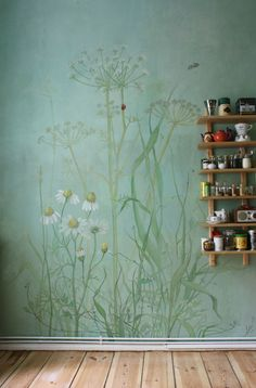 Hand painted mural and open shelving with vintage kitchen items.