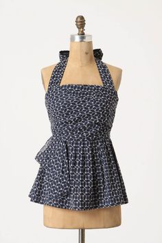 "Star Trails Halter on #anthropologie with side zip, ties at neck and waist. Maeve's pleated-bust cotton top boasts geometric stitches that twinkle at ever corner.        Ties at neck      Side boning      Side zip      Cotton      Dry clean      Regular: 19.25""L      Petite: 16.75""L      Imported"