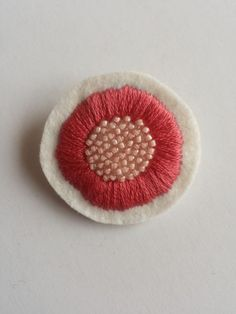 Hand stitched brooch
