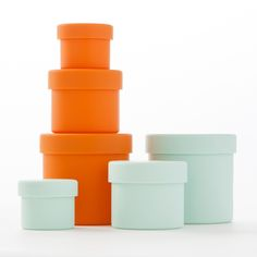 """Go ahead, squeeze it. These colorful containers will always pop back into shape. Made from gently cushioning, sound-absorbing silicone, these Squish containers are perfectly suited for organizing personal care items in your bathroom. Nest the 3 sizes of round containers together for easy storage when not in use.   Set Includes: 3 Containers  • 1 Small (2.2"""" dia x 1.8"""" ) • 1 Medium (3"""" dia x 2.5"""") • 1 Large (3.5 """" dia x 3.5"""" )  Color Options: Mint or Mango"""