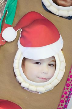 "Making Santa ""masks"" with packing peanuts, a paper plate, and a paper santa hat. Activity reinforces counting skills, number concepts, and fine motor control. Do this activity after reading ""I see Santa Everywhere"""