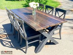 This Custom Dining Table was built using Reclaimed Douglas Fir, treated with an all natural vinegar solution to grey the wood. The chairs and trestle bases were painted black and sanded at the edges and wear points.