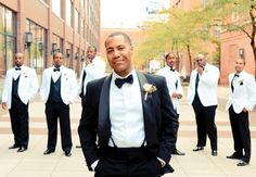 Classic look for the grooms, opposite look for the groomsmen. Love it!