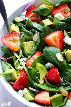 Avocado Strawberry Spinach Salad with Poppy Seed Dressing  Salad Ingredients:  6 cups fresh baby spinach, 1 pint strawberries, hulled and sliced  1 avocado, diced, 4 ounces crumbled gorgonzola or blue cheese, 1/4 cup sliced almonds, toasted  half a small red onion, thinly sliced.  Poppyseed dressing