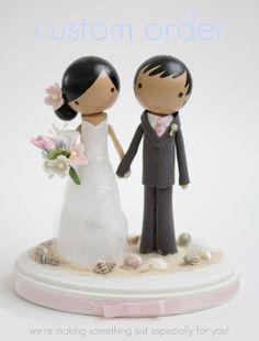 This shop ( http://www.etsy.com/shop/lollipopworkshop) found on Etsy.com custom cake toppers that are meant to resmble yourself & the groom. This is just one I found on their website, but I had them do mine for our wedding and it was worth EVERY penny!