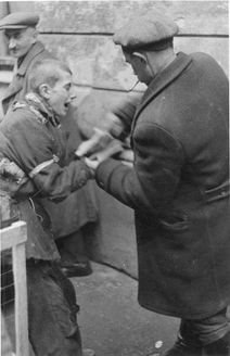 Warsaw, Poland, 1941-1942, A child caught stealing an apple.