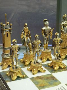 Silvered and Gilded Bronze Vasari Figural Chess Set on a board of silver framed polished Italian onyx