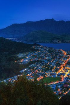 Gazing over Queenstown, New Zealand art night. The Remarkables in the background | The Planet D Adventure Travel Blog: