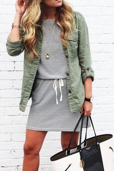 Street fashion   Khaki shirt over striped mini dress