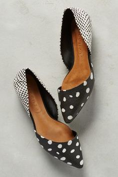 Black-and-white polka-dotted flats