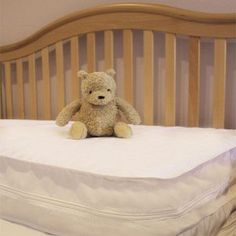 Teddy bear on a clean crib mattress