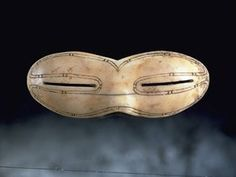 Inuit snow goggles. Quebec/Ontario: World's first sunglasses. Referred to as snow goggles, they were made from bone, leather or wood, designed to protect the eyes from snowblindness caused by bright spring sunlight. The first goggles date back 2000 years to the Old Bering Sea culture, who were the ancestors of the modern Inuit. Snow goggles came to Canada with the Inuit about 800 years ago. This example is from north Baffin, is walrus ivory, made between 1200-1600AD.