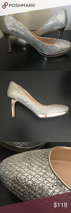 Ivanka Trump Wedding Heels Silver and gold statement heels that compliment any wedding dress. Worn for one wedding dress fitting and my wedding day and kept in pristine condition since. These are no longer available in stores. Ivanka Trump Shoes Heels