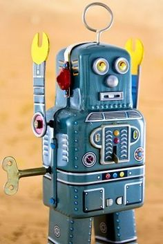 Retro robot toy. I love his little yellow pinchers, like, so much.