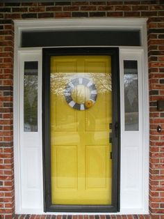 The midview white storm door adds traditional detailing to the front
