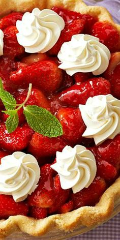 Fresh Strawberry Pie _ After just one bite, you'll be hooked on this luscious fruit pie complete with a sweet strawberry filling & flaky pastry crust. Once chilled, top the pie with mint springs for fresh, cool flavor! #Recipes