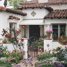 > > > Elaborate Mediterranean-style/spanish-style homes may feature intricate tilework, as seen above the front door of this house. Additionally, the windows are embellished with wrought-iron details. Mediterranean Style Homes, Spanish Style Homes, Spanish House, Spanish Tile, Spanish Revival, Mediterranean Garden, Mediterranean House Exterior, Spanish Colonial Decor, Mexican Style Homes