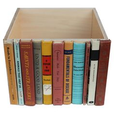 Glue old hardback book spines to side of a plain wooden box- perfect hidden bookshelf storage!