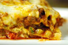 Venison Lasagna - ground pork or wild boar, ground venison or ground beef, onion, garlic, crushed tomatoes, tomato sauce, tomato paste, red wine, fennel seeds, fennel pollen (optional), sugar, basil leaves, oregano, ricotta cheese, mozzarella cheese, pecorino cheese, nutmeg, parsley, lasagna noodles, Salt and pepper
