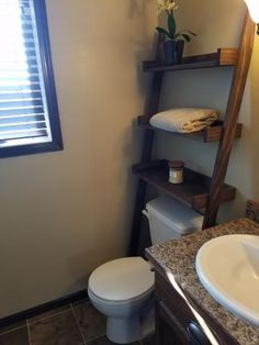 Leaning Bathroom Ladder Over Toilet Shelf
