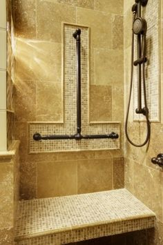 """Grab bars are one of the safety features that have traditionally screamed """"institutional."""" That sterile public-restroom look is one reason that people resist installing them. But take a look at these: The shape and the oil-rubbed bronze color offer a warm, traditional look."""