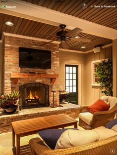 Brick patio fireplace w wood mantle. Patio furniture