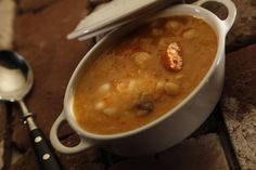 Pochas (White beans with chorizo and pork riblets soup) Bodegas Muga, Pork Riblets, Bechamel Sauce, Red Tomato, Lamb Chops, Bean Soup, White Beans, Chorizo, Cheeseburger Chowder