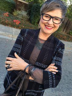 Brenda wearing backwards necklace