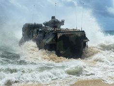 To help defend its island territories, Japan will add 52 AAV-7 amphibious landing vehicles. Above, a US Marine amphibious assault vehicle launches from the beach to amphibious dock landing ship USS Rushmore during Rim of the Pacific Exercise 2014. (Photo: MC1(NAC) Shannon E. Renfroe/US Navy)