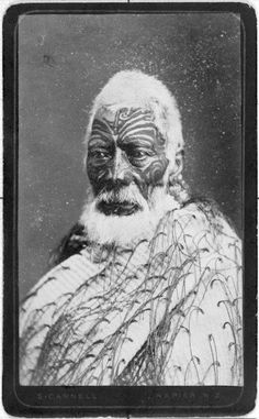 Matenga Tukareaho, [ca 1870] Head and shoulders portrait of Matenga Tukareaho of Nuhaka. He has a full facial moko and wears a tag cloak. Photograph taken by Samuel Carnell.