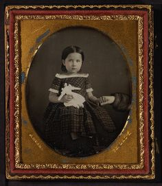 Girl with doll, c 1853. The little girl had to sit a while for the photo process, so her mother(?) held her hand. very sweet.  Maker: C. Evans. From the George Eastman House Collection.