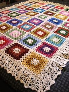 """Vanna's Choice and Red Heart acrylic yarn for this granny-ghan; size """"I"""" crochet hook. The edging is from Doris Chan's """"All Shawl"""" pattern (Ravelry link)."""