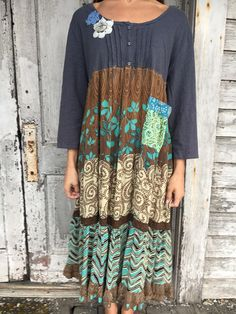Romantic/Tattered/Rustic/Boho/Gypsy Dress upper part of dress is made with cotton and has added crochet flowers along front lower part is made with cotton / rayon and has added pocket pocket and tie along back Size-Xlarge plus chest-50 has stretch hips-free length-45