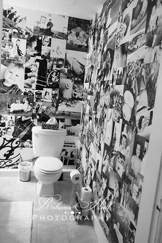 Wow! Portraits as wallpaper. Not sure I'd choose the bathroom as my place to do this, but it's such a great idea.
