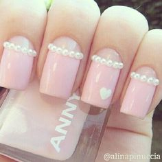 Light pink nails with pearls and heart design.