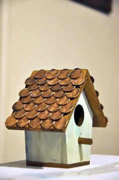 Made the blue stain for the wood with vinegar and pennies, then used the pennies as the shingles for the house.