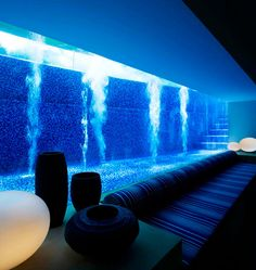 This pool his contained in glass at ground level, creating a block of blue water as a visual anchor to the home.