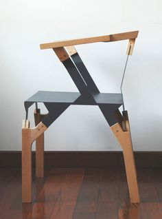 Li Yun/ Diplome project / 2007 / The inspiration of Wood metal Chair comes from the combination of wood and steel, such as knives, saws, and some other manual tools whose structure is simply set by a piece of steel placed in between two pieces of wood and then bolted.