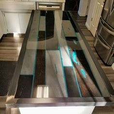 Custom Kitchen Island top made to accentuate the existing colors of the room and bring in a POP of BLUE ! Comment below to let us know what you think of this color combination. Custom Kitchen Island top made to