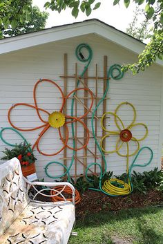 flowers made from colorful garden hoses