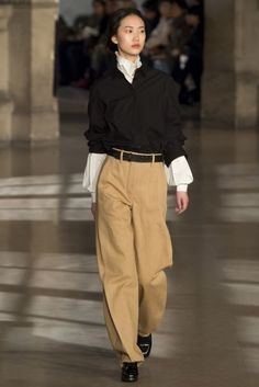 Herald the return of chinos | Lemaire was awash with Nineties preppy minimalism. The key piece? Stone-coloured chinos. Wear with block heels and belt high on the waist - less dad, more distinguished. | Vogue's 7 Autumn/Winter 2016 Style Tricks To Try Now
