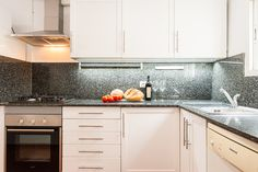 Kitchen in modern apartment in Gracia, Barcelona. Advanced Home Staging | Markham Stagers, Barcelona